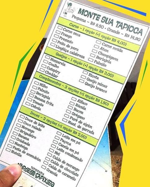 Cardápio da cor amarela, branca e verde da Tapiocaria Nordeste Capixaba publicada no Facebook da empresa.