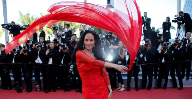 "Actress Sonia Braga poses on the red carpet as she arrives for the screening of the film ""Elle"" in competition at the 69th Cannes Film Festival in Cannes"